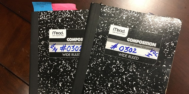 Duncan showed her two notebooks with juror number #0302 on the covers.