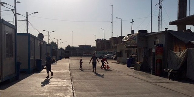 Children playing in Baghdad's Camp Virgin Mary, which is for displaced Christians.