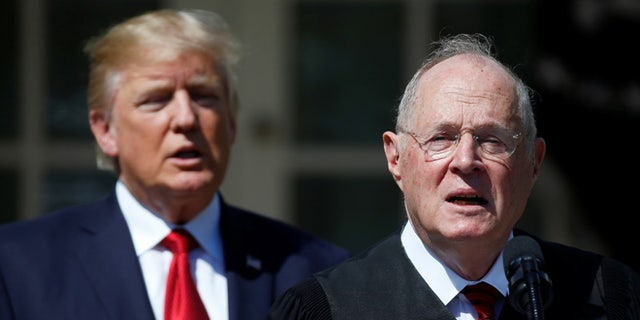 FILE: April 10, 2017: President Trump stands next to Supreme Court Justice Anthony Kennedy in the White House Rose Garden, in Washington, D.C.
