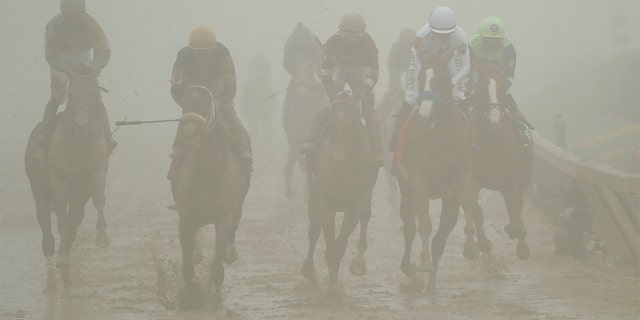 Horses ran in the fog and mud during the Preakness Stakes on Saturday.