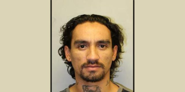 Authorities are searching for Justin Joshua Waiki, who is accused of killing a police officer during a traffic stop.