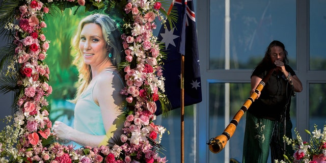 In this Aug. 11, 2017, file photo, Johanna Morrow plays the didgeridoo during a memorial service for Justine Damond in Minneapolis