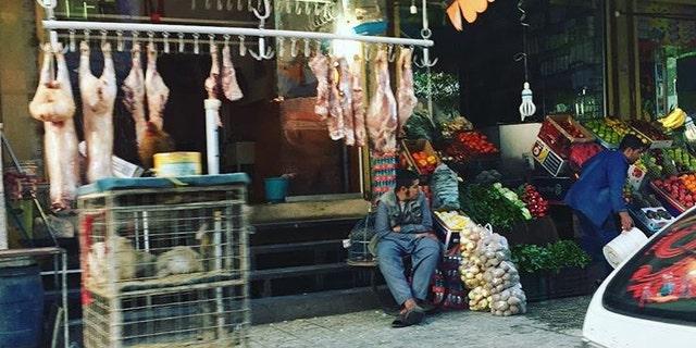 Marshal Azizi at an outdoor shop