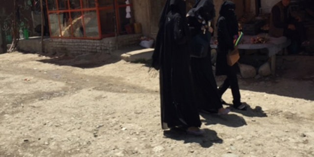 Women at an outdoor market in Kabul