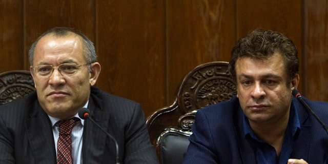 Kabul Bank Chairman Sherkhan Farnood (l.) and Kabul Bank CEO Khalilullah Ferozi, (r.), were among several charged with stealing $1 billion.