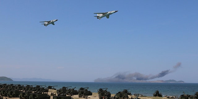 "Aug. 26, 2017: Jets perform a flyby after a live fire ""target-striking contest"" held by North Korean leader Kim Jong Un just next to Kalma International Airport in Wonsan, North Korea. The country is trying to turn the beach region into a bustling tourist destination."