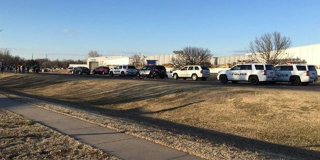 In this photo provided by KWCH-TV, police vehicles line the road after reports of a shooting in Hesston, Kan., Thursday, Feb. 25, 2016. A Harvey County sheriff's dispatcher said the shooting occurred Thursday afternoon at Excel Industries.