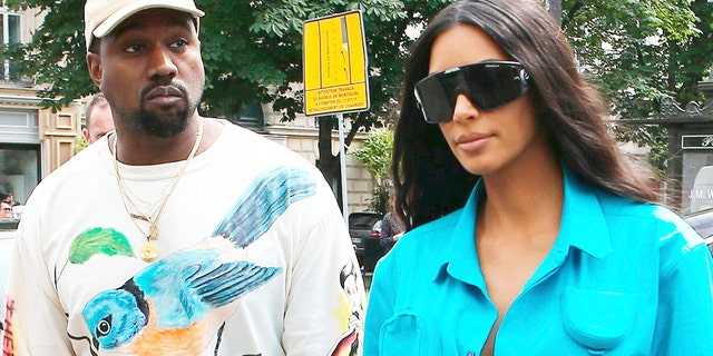 Kim Kardashian took her husband Kanye West to the ER after he reportedly came down with the flu, a new report says. The couple is pictured here in Paris.
