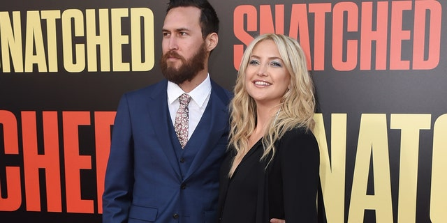 Danny Fujikawa, links, and Kate Hudson, are engaged after five years together.