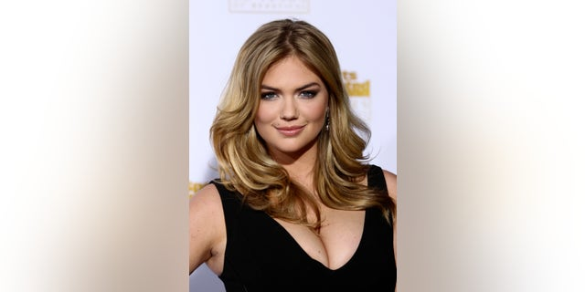 January 14, 2014. Kate Upton arrives for the 50 Years of Beautiful broadcast special show celebrating the 50th Anniversary of the Sports Illustrated Swimsuit Issue at the Dolby Theater in Los Angeles, California.