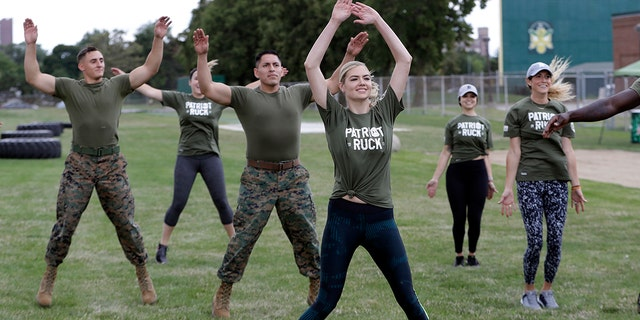 """Model and actress Kate Upton takes part in a """"workout with the Marines"""" to raise awareness for Marine Week, Tuesday, Aug. 22, 2017, in Detroit. Upton, fiancé of Detroit Tigers pitcher and Wins for Warriors founder Justin Verlander, and other Tigers Wives participated in a scaled-down workout led by Gunnery Sergeant Sara Pacheco to help support and promote the 2017 Wins for Warriors Patriot Ruck, taking place Saturday, Sept. 9 in Detroit. (AP Photo/Carlos Osorio)"""