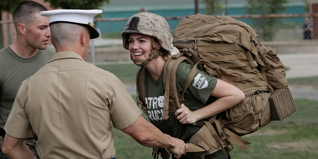 Model and actress Kate Upton tries on a Marine ruck to raise awareness for Marine Week, Tuesday, Aug. 22, 2017, in Detroit. Upton, fiancé of Detroit Tigers pitcher and Wins for Warriors founder Justin Verlander, and other Tigers Wives participated in a scaled-down workout led by Gunnery Sergeant Sara Pacheco to help support and promote the 2017 Wins for Warriors Patriot Ruck, taking place Saturday, Sept. 9 in Detroit. (AP Photo/Carlos Osorio)