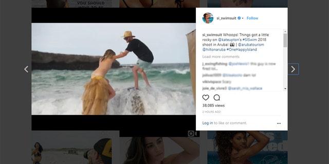 Kate Upton falls during a photo shoot in Aruba.