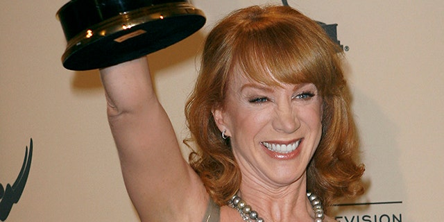 """Actress and comedian Kathy Griffin celebrates her Emmy win in """"Outstanding Reality Program"""" for """"My Life on the D-List"""" during the Primetime Creative Arts Emmy Awards in Los Angeles September 8, 2007. REUTERS/Gus Ruelas (UNITED STATES) - RTR1TMAX"""
