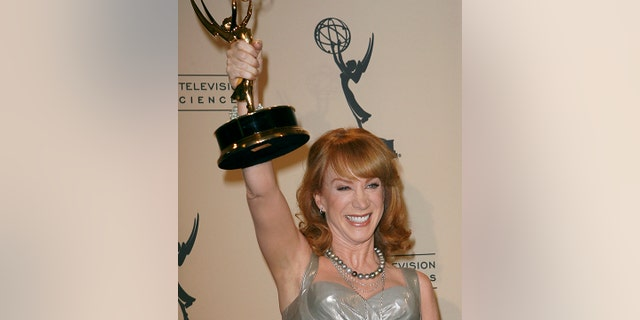 "Actress and comedian Kathy Griffin celebrates her Emmy win in ""Outstanding Reality Program"" for ""My Life on the D-List"" during the Primetime Creative Arts Emmy Awards in Los Angeles September 8, 2007. REUTERS/Gus Ruelas (UNITED STATES) - RTR1TMAX"