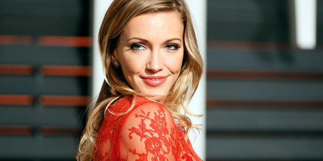 Actress Katie Cassidy arrives at the 2015 Vanity Fair Oscar Party in Beverly Hills, California February 22, 2015.