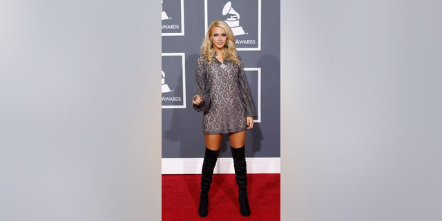 """Jones, seen above at the 52nd annual Grammy Awards in 2010, claims American made her """"miss"""" her flight, though the airline suggested in a statement that the flight has yet to take off."""