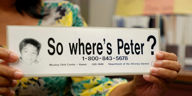 """File - This June 6, 2016 file photo taken in Honolulu shows a bumper sticker Hawaii officials distributed in a campaign for a Hawaii boy who disappeared 20 years ago. The child, known as """"Peter Boy,"""" became the face of missing and abused children in the late 1990s and early 2000s. The father of a Hawaii boy who went missing 20 years ago has led police to the site Sunday, April 23, 2017, where he disposed his son's remains. Peter Kema Sr. is providing information about the location of the boy's body as part of a plea deal reached earlier this month. (AP Photo/Jennifer Sinco Kelleher, File)"""