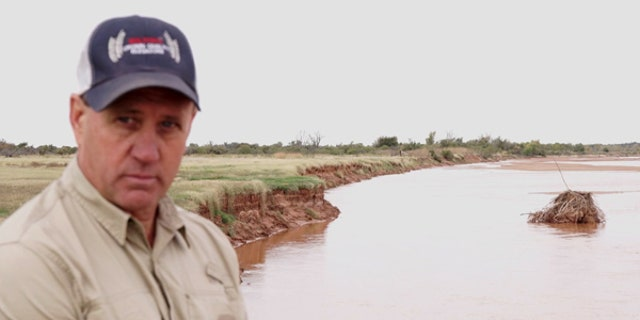 Ken Aderholt is pictured here along the bank of the Red River in Wilbarger County, Texas.