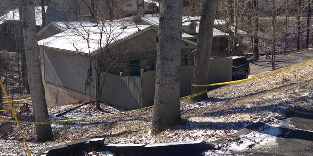Feb. 15, 2015: Yellow tape surrounds a home in southeast Kentucky where a family was found dead. A couple and a young girl were reportedly found dead in the home on Saturday. Police are investigating to see if the case is connected to the shooting death of a young man in Baltimore on Saturday.