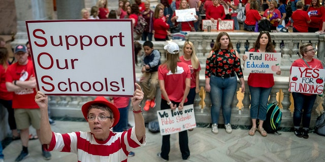 Teachers from across Kentucky gather at the state Capitol in Frankfort to rally for increased funding for education, April 13, 2018.