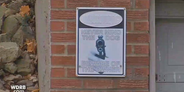"""Derek Thomas has a sign out front of his home that says, """"Never mind the dog. Beware the owner."""""""
