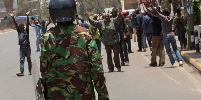 Riot police prevent demonstrators from reaching the Independent Electoral and Boundaries Commission offices in Nairobi, Kenya, Oct. 2, 2017.