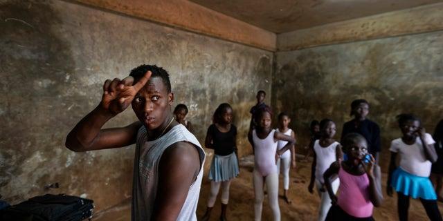 Young ballerinas receive instruction from Kenyan ballet dancer Joel Kioko, 16.