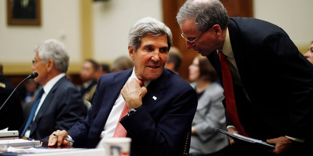 Sept. 4, 2013: Secretary of State John Kerry confers with U.S. Ambassador to Syria Robert Ford, right, as Kerry testifies at a House Foreign Affairs Committee hearing on Syria on Capitol Hill in Washington.