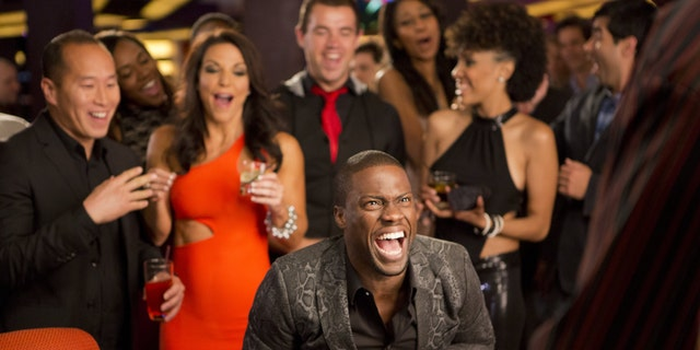 """Kevin Hart, center, as Cedric in a scene from """"Think Like A Man Too."""""""