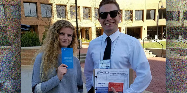 """Students Kaitlin Bennett (L) and Kevin Cline (R) participate in a """"Restore the Fourth Amendment"""" event at Kent State University."""