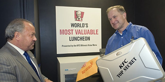 Corporate security expert Bo Dietl (l.) watches as Roger Eaton, president of KFC USA, places Colonel Harland Sanders' handwritten Original Recipe into KFC headquarters' newly modernized vault in April, 2009.