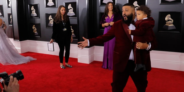 Khaled with son Asahd on the Grammys red carpet.