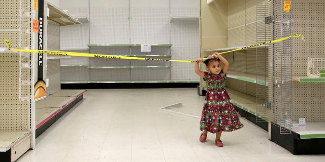 A young plays in an empty isle of a Toys R Us store in Houston on Thursday, June 28, 2018.