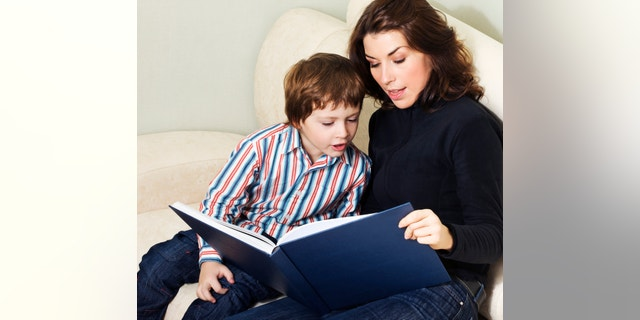 Mother reading to her child an interesting story