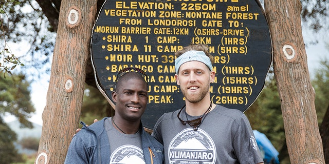 Cpl. Kionte Storey, 29, (left) and Jake Rath, 25, (right) at the base of Mount Kilimanjaro in Tanzania.