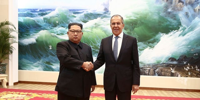 Korean leader Kim Jong Un, left, and Russia's Foreign Minister Sergei Lavrov pose for a photo during a meeting in Pyongyang, North Korea, Thursday, May 31, 2018 .