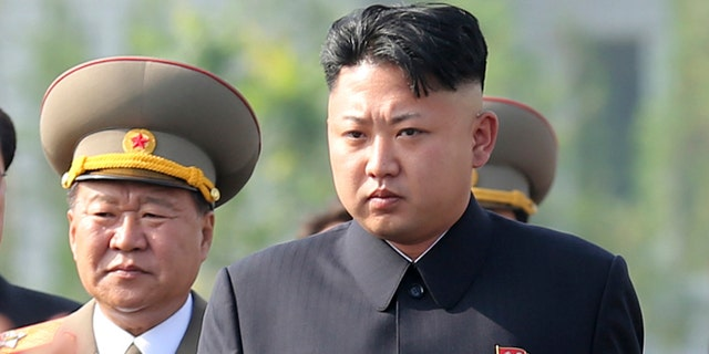 July 25, 2013: In this file photo, North Korean leader Kim Jong Un, center, arrives at the cemeteries of fallen fighters of the Korean People's Army (KPA) in Pyongyang, North Korea.