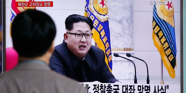 April 11, 2016: A man watches a TV news program showing file footage of North Korean leader Kim Jong Un at Seoul Railway Station in Seoul, South Korea