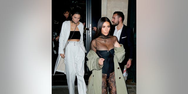 Kris Jenner, Kendall Jenner and Kim Kardashian leaving the Kinu restaurant in Paris the Saturday night before Kim was held at gunpoint during a $10m robbery on October 1, 2016.