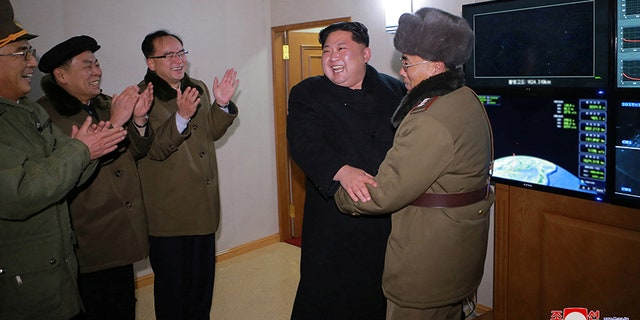 North Korea's leader Kim Jong Un reacts to the Hwasong-15's test launch, in this undated photo released by North Korea's Korean Central News Agency (KCNA) in Pyongyang on Nov. 30, 2017.