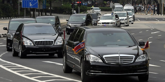 A motorcade believed to be carrying North Korean leader Kim Jong Un travels along Singapore's Orchard Road, June 10, 2018.