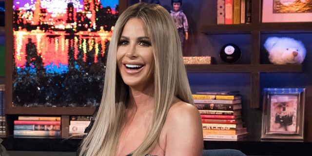Kim Zolciak gifted her daughter Brielle a rose gold pistol for her 21st birthday.