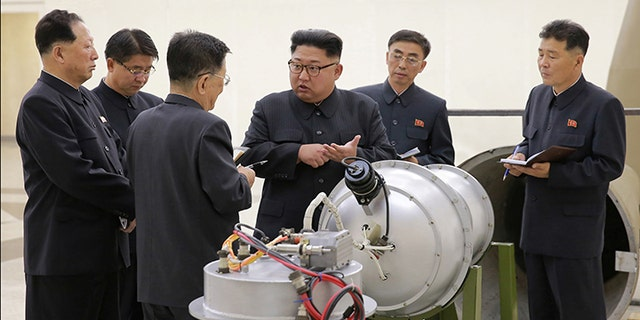 Kim Jong Un provides guidance with Ri Hong Sop (3rd L) and Hong Sung Mu (L) on a nuclear weapons program in this undated photo released by North Korea's Korean Central News Agency (KCNA) in Pyongyang, September 3, 2017.