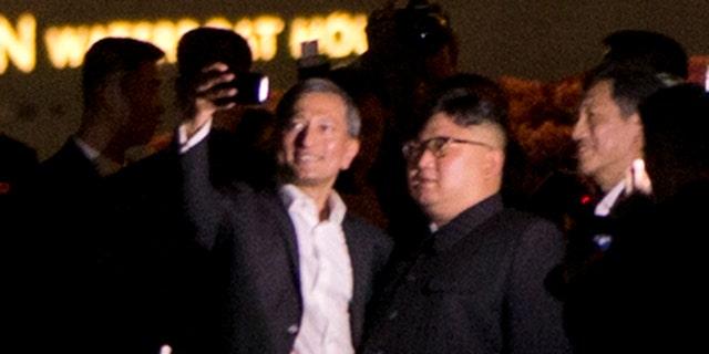 Kim Jong Un leaving St. Regis Hotel in Singapore for a mini tour of the city.