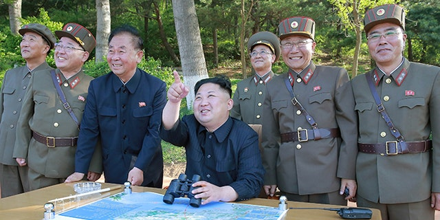 North Korean leader Kim Jong Un inspects the intermediate-range ballistic missile Pukguksong-2's launch test May 22, 2017.