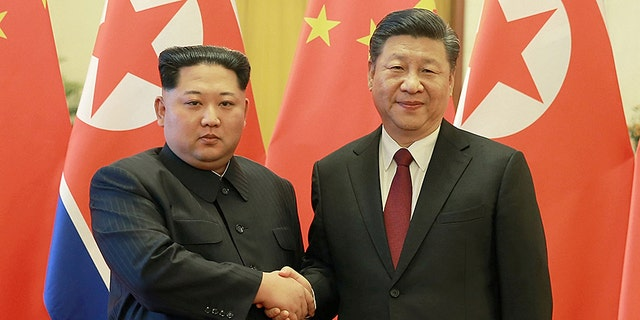 Kim Jong Un and Xi Jinping during their first meeting in late March.