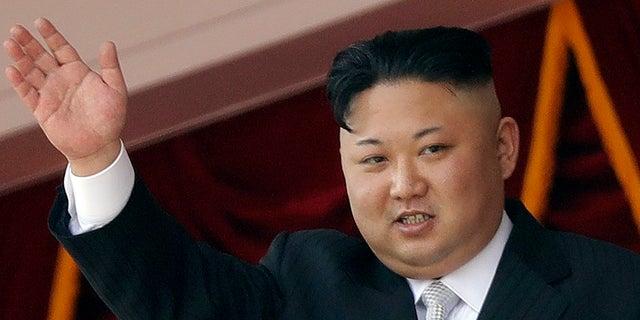 Kim Jong Un waves during a military parade in Pyongyang, North Korea, on April 15.