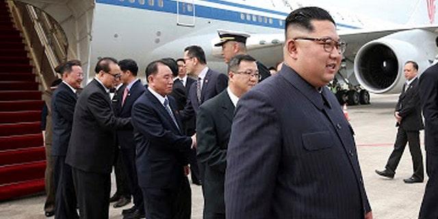 North Korean leader Kim Jong Un, right, arrives at the Changi International Airport, in Singapore, June 10, 2018.