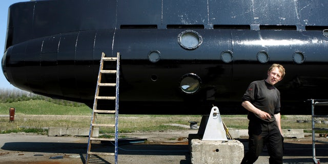 This April 30, 2008 file photo shows a submarine and its owner Peter Madsen.